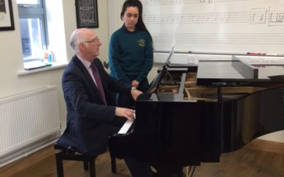 Mr Padhraic O'Cuinneagain working with Leaving Cert student Eimear Kyle at a Piano Masterclass